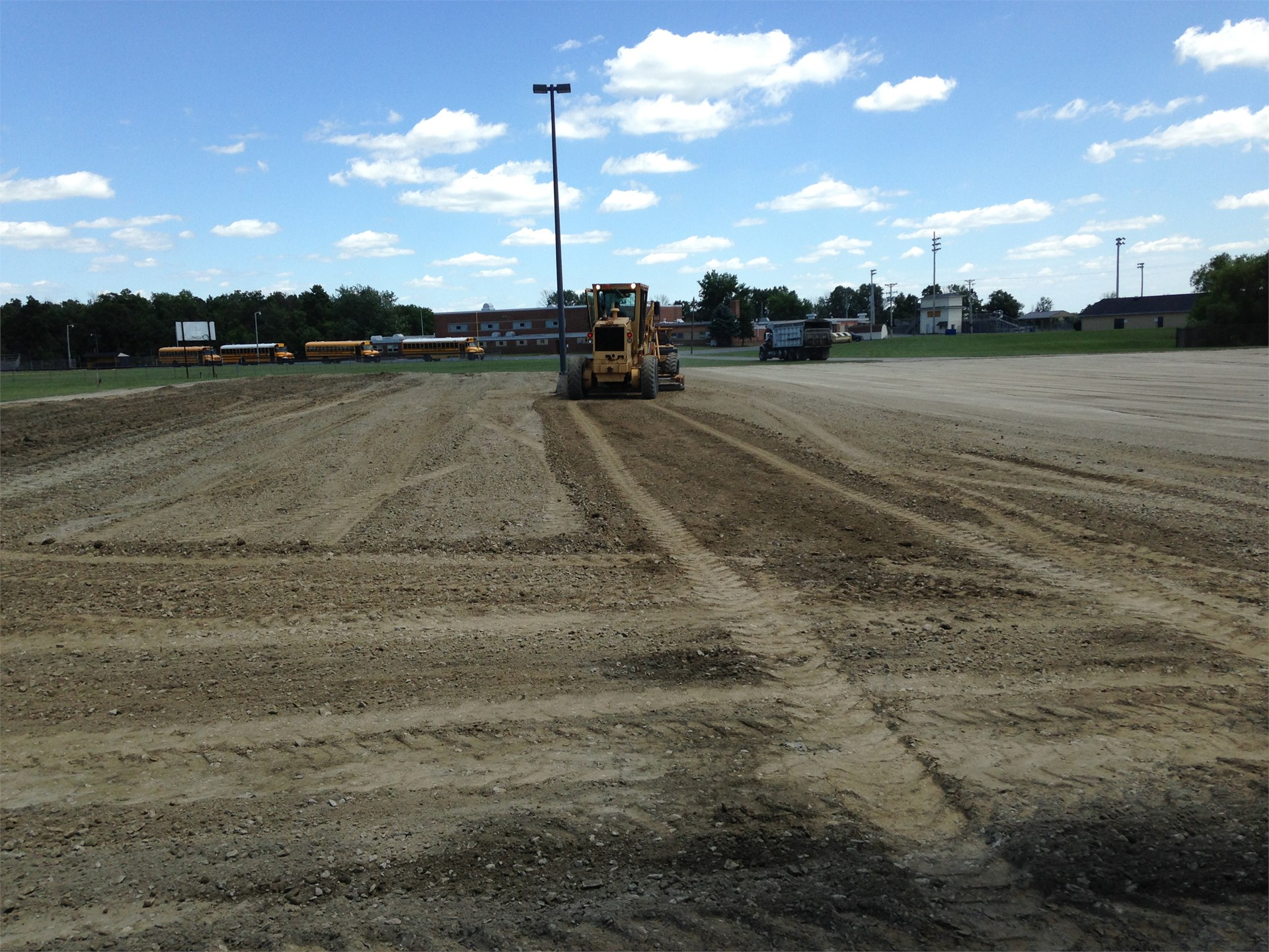 Parking Lot Rolling and Grading to improve water removal