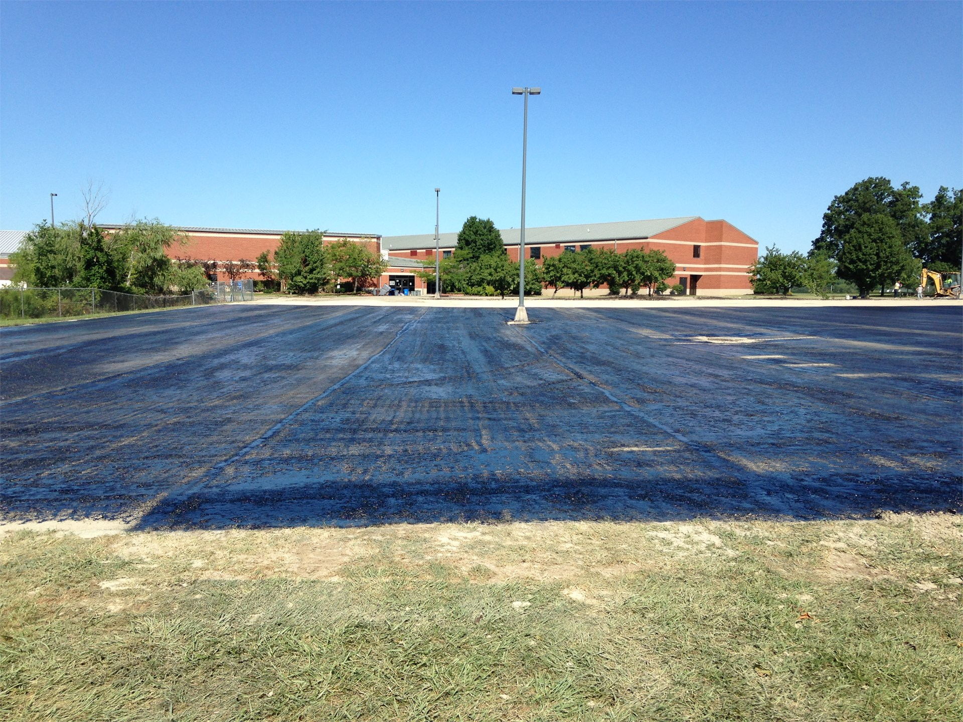 BREC Lot with Cure Coat being applied for Asphalt