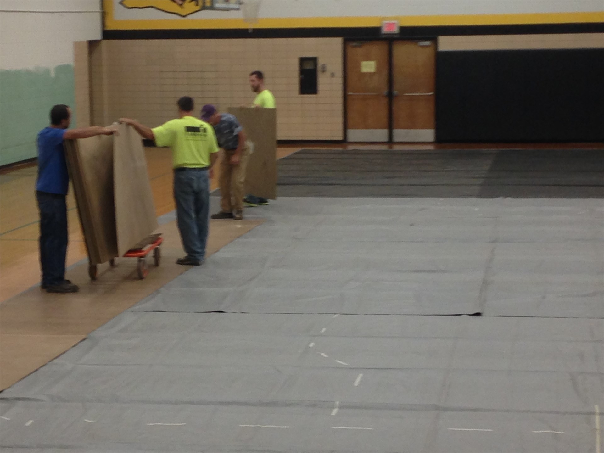 Farnham Equipment prepping floor for  bleacher installation