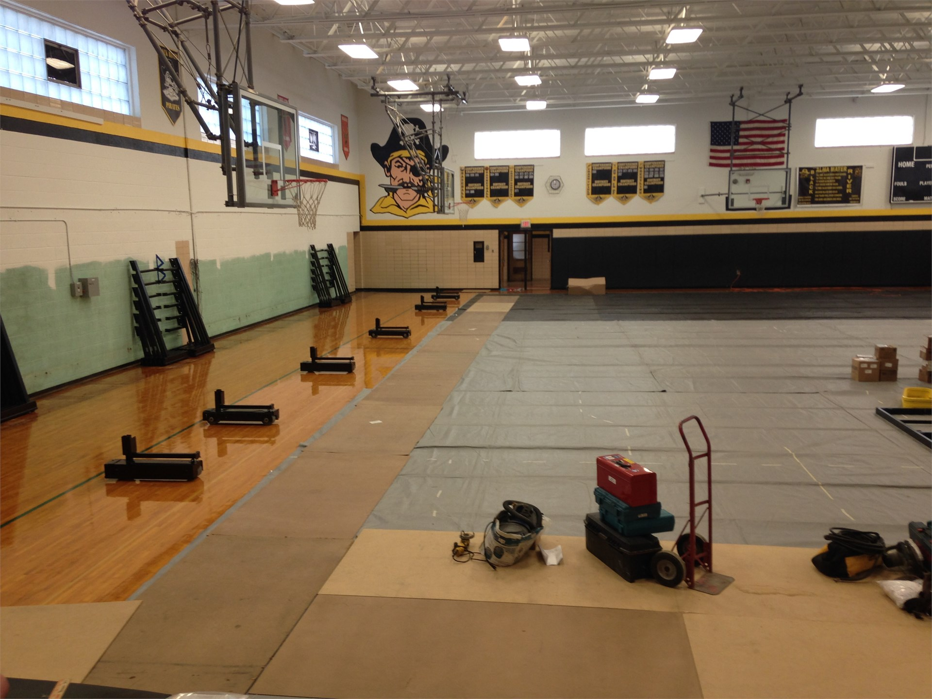 Bleacher motors and pullouts being placed