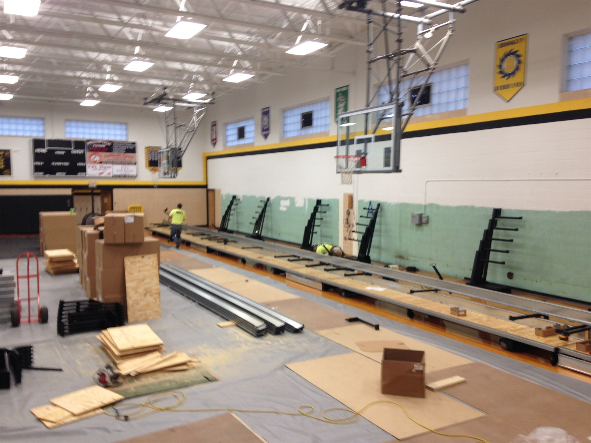 First row of bleachers being assembled.