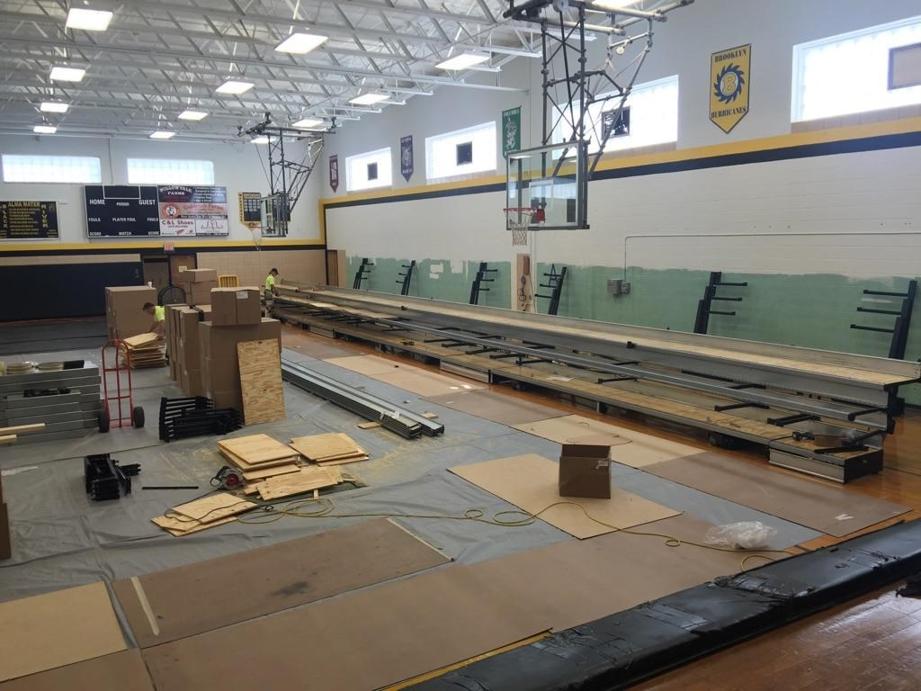 Third row of home bleachers being assembled