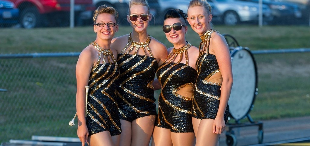 four members of dance team outside smiling