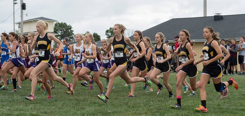 cross country athletes running in meet