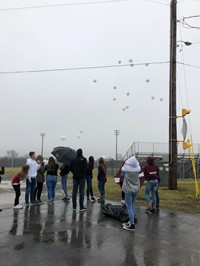 Students releasing balloons at balloon launch